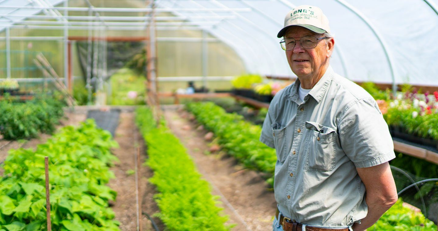 Southwest Washington Food Hub - Local Producer in Greenhouse